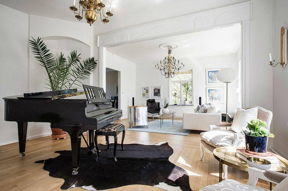 Klassiska designmöbler och second hand-fynd i överstevillan